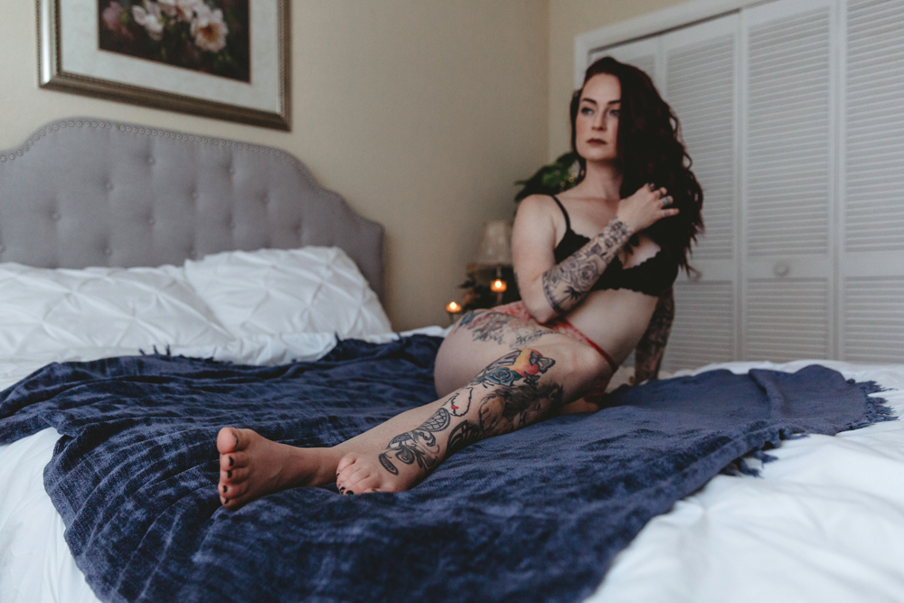 Naples Boudoir Photographer, woman resting on a blue blanket on her bed