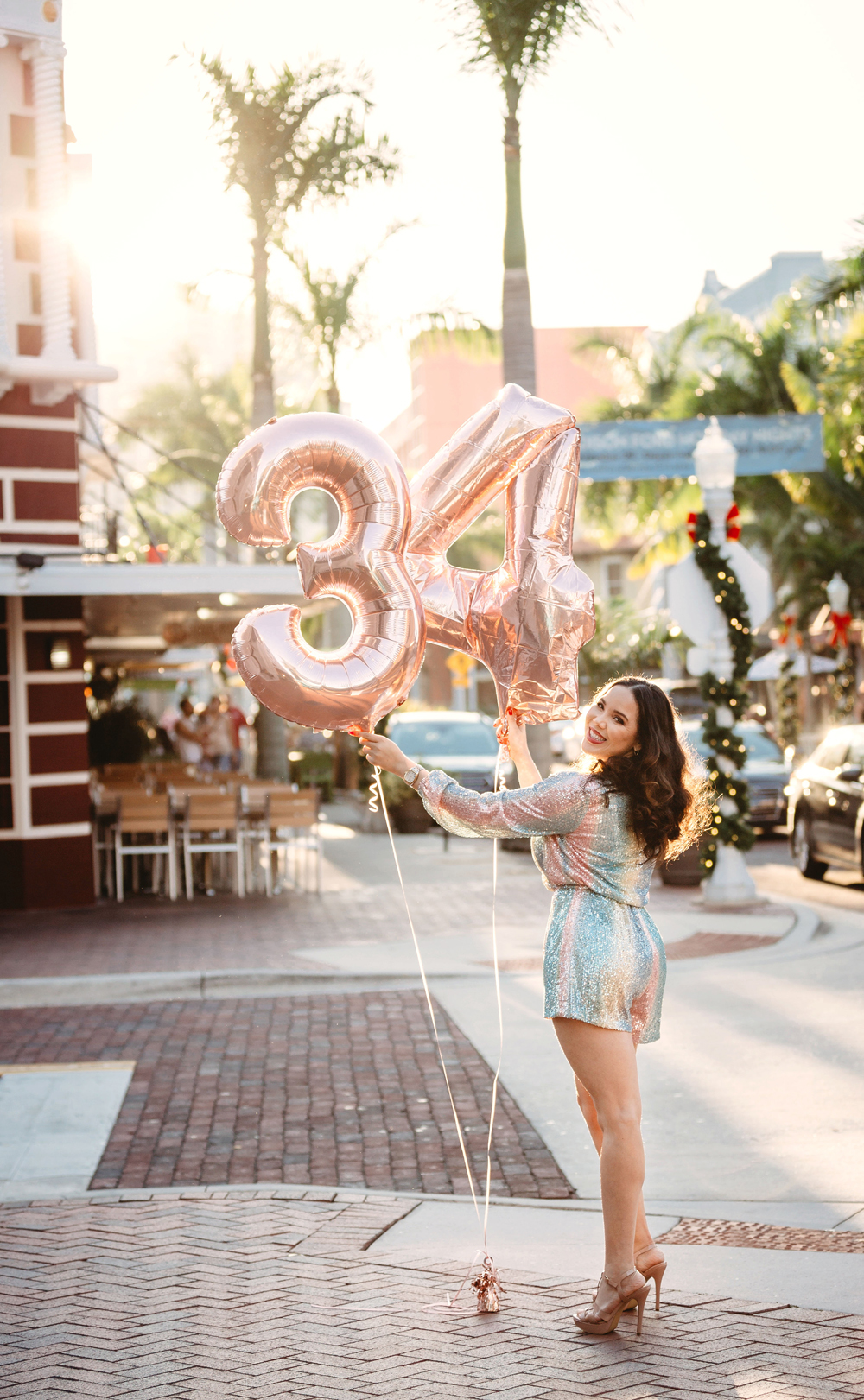 "Naples Branding Photographer, woman holding a ""34"" balloon"
