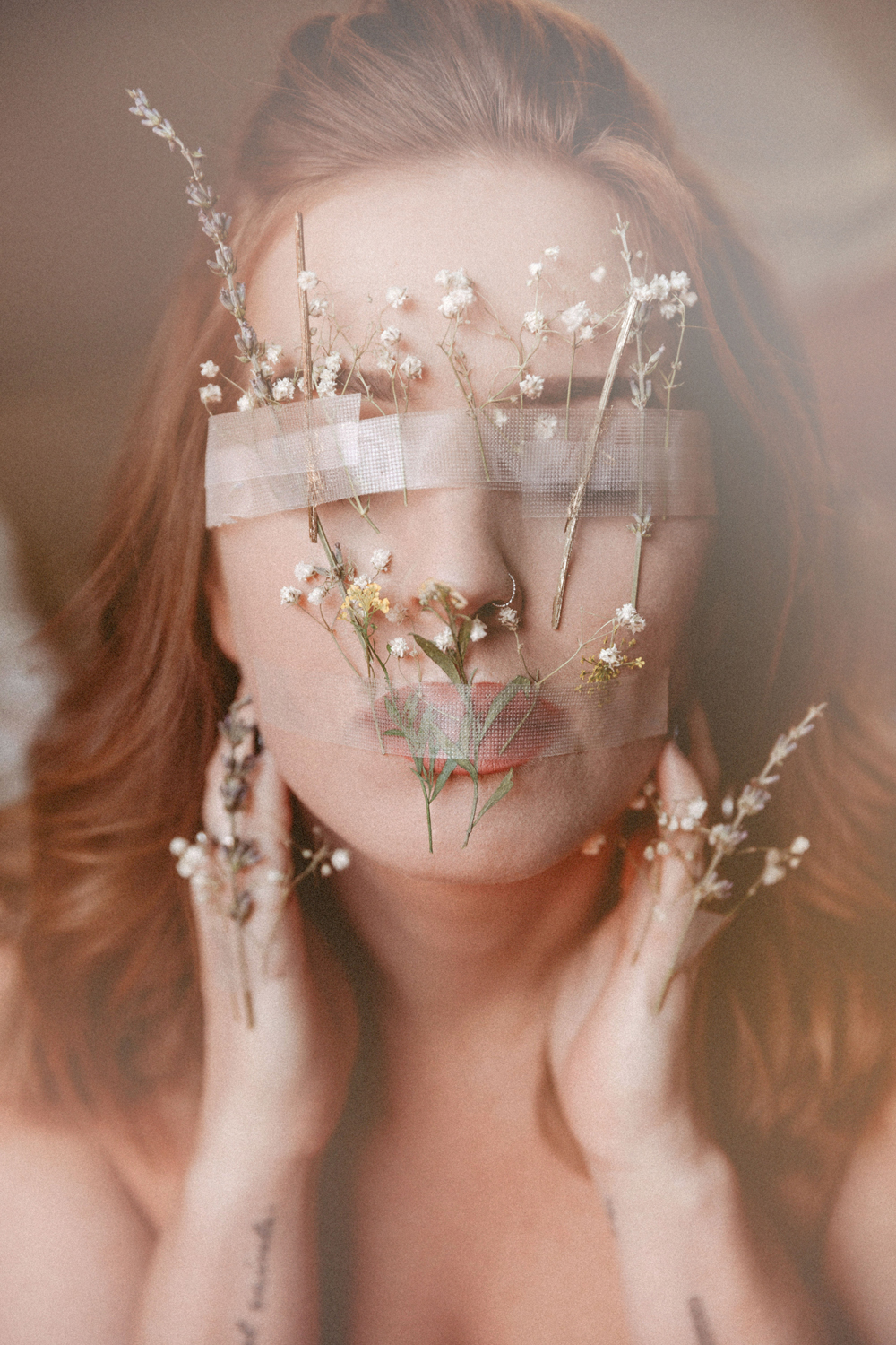 Naples Branding Photographer, woman with wild flowers taped over her mouth and eyes