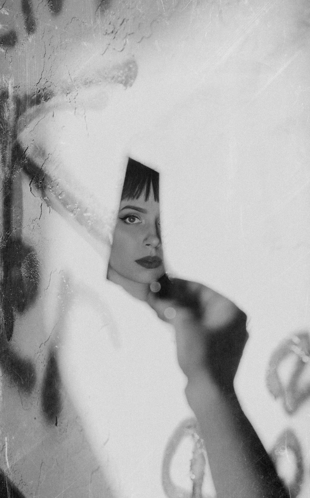 Naples Branding Photographer, woman posing behind sheets