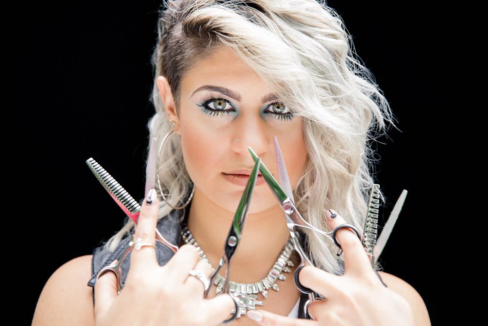 Naples Branding Photographer, hairdresser holding up scissors