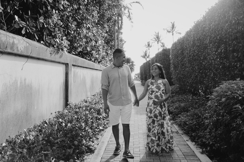 Naples Family Photographer, pregnant couple walking on a pathway