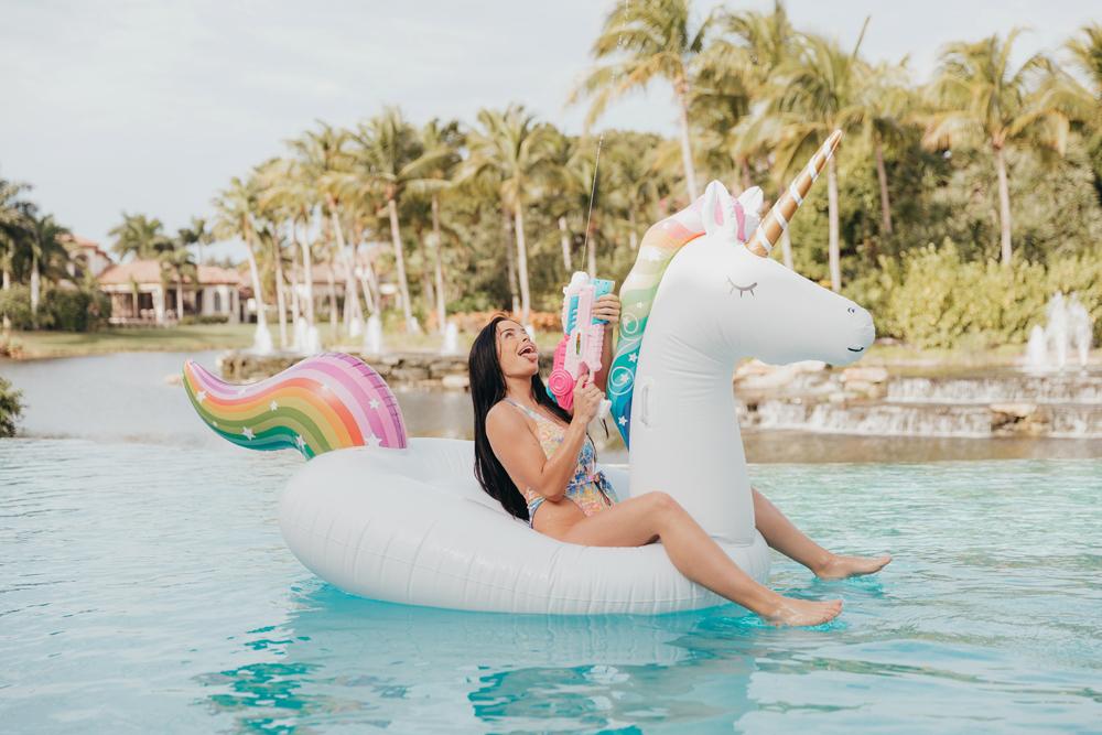 Naples Branding Photographer, woman on a unicorn pool floatie