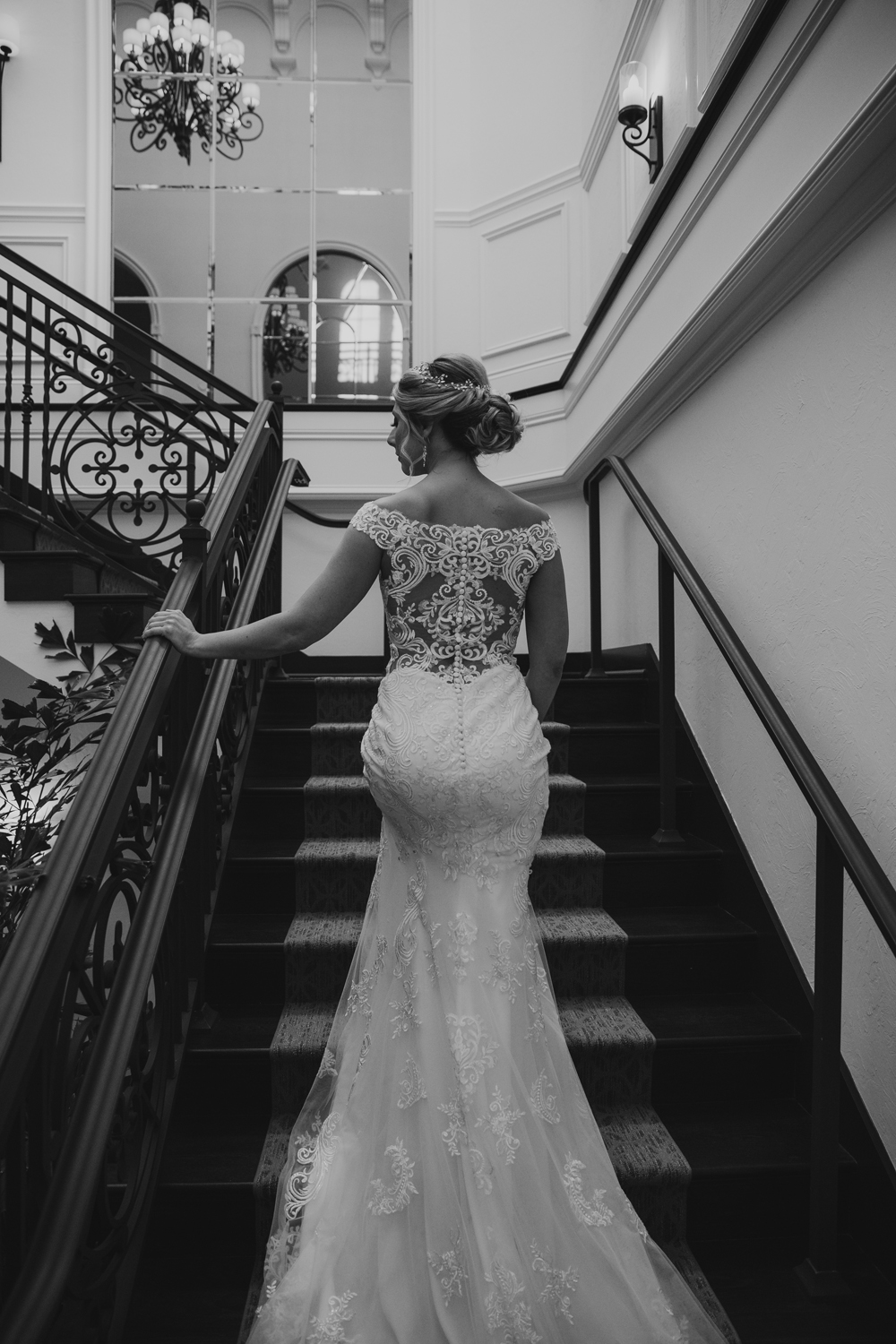 Naples Wedding Photographer, bride standing on stairs