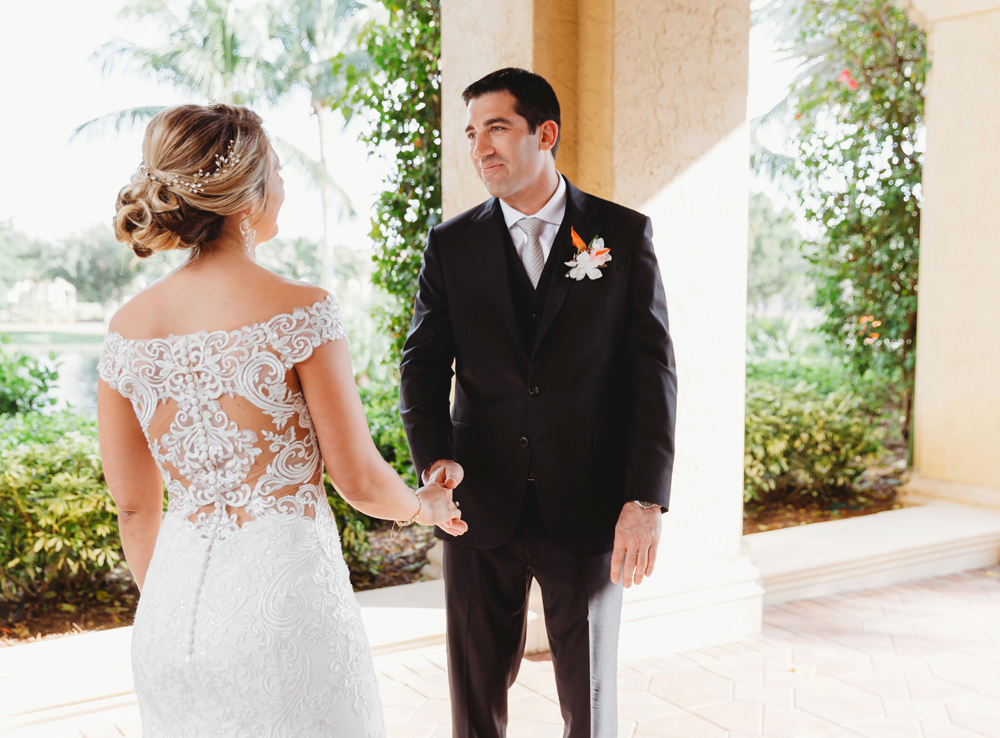 Naples Wedding Photographer, bride and groom holding hands
