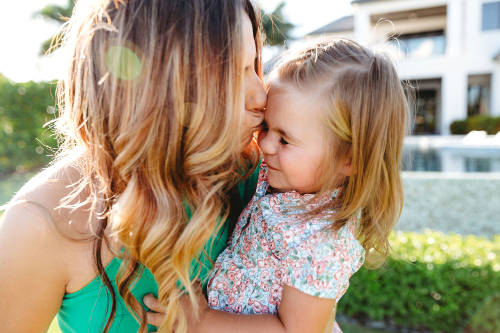Naples Family Photographer, mother kissing daughter on her forehead