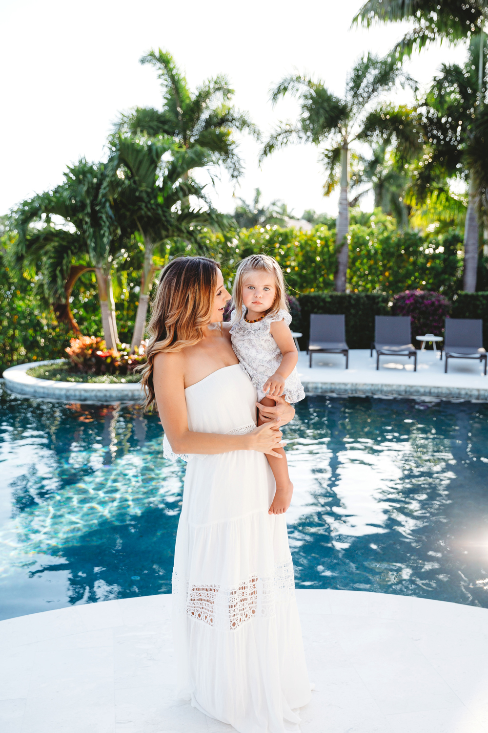 Naples Family Photographer, mother and daughter standing next to a pool