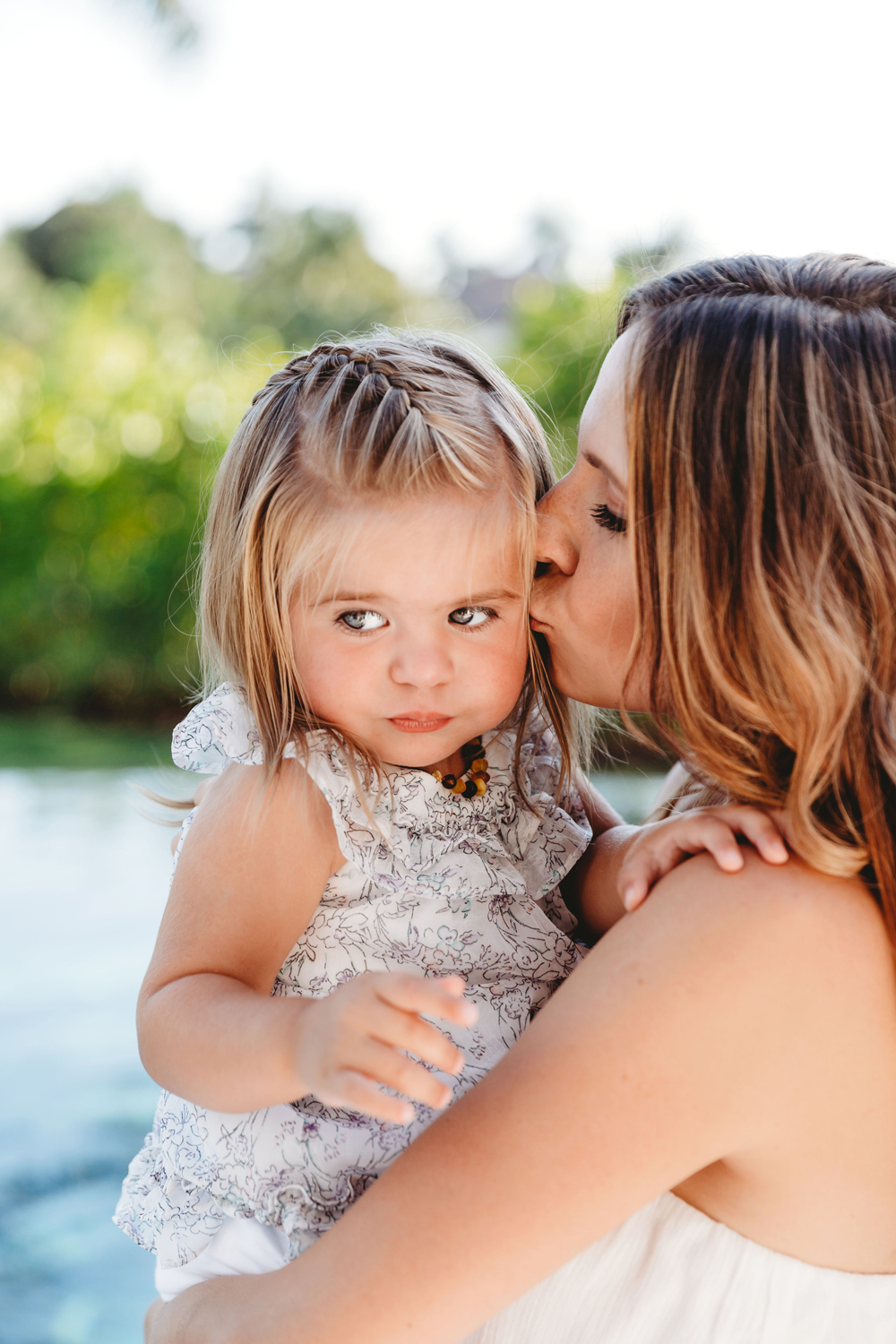 Naples Family Photographer, mother kissing daughter's cheek