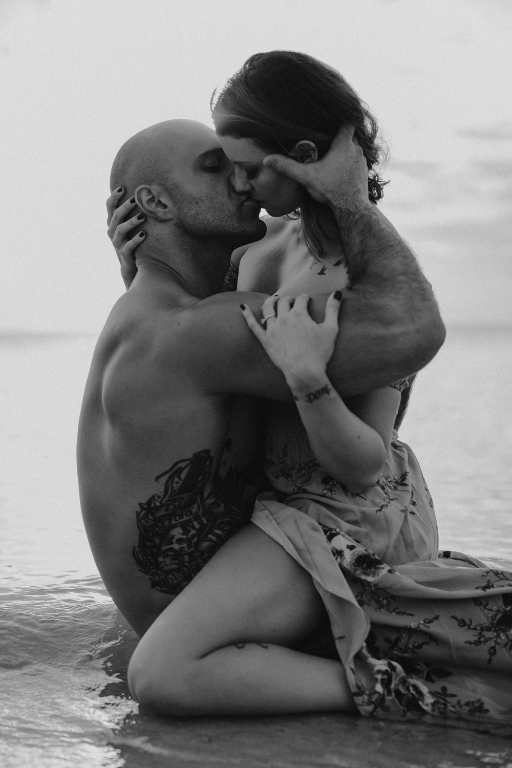 Naples Couples Photographer, black and white image of couple holding each other and kissing