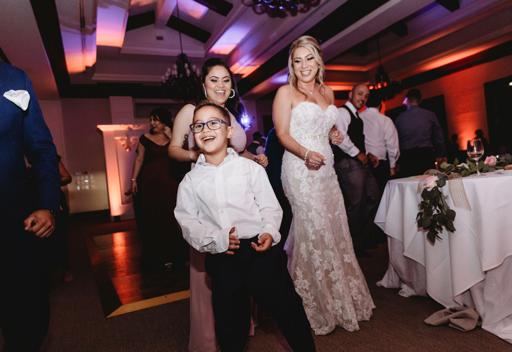 Naples Wedding Photographer, little boy dancing with bride