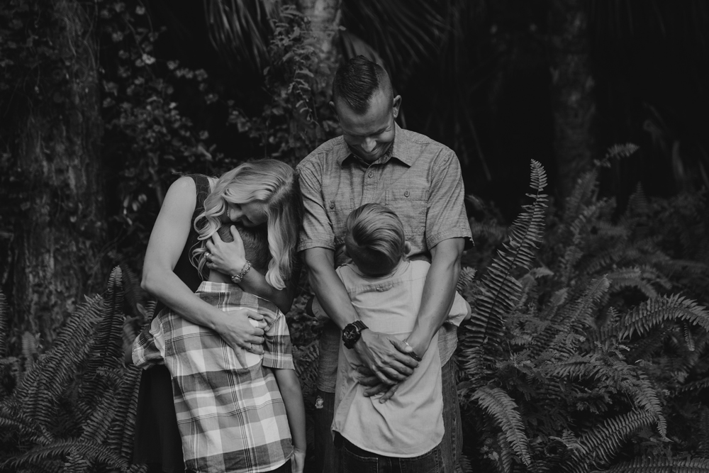 Naples Family Photographer, mother and father hugging children