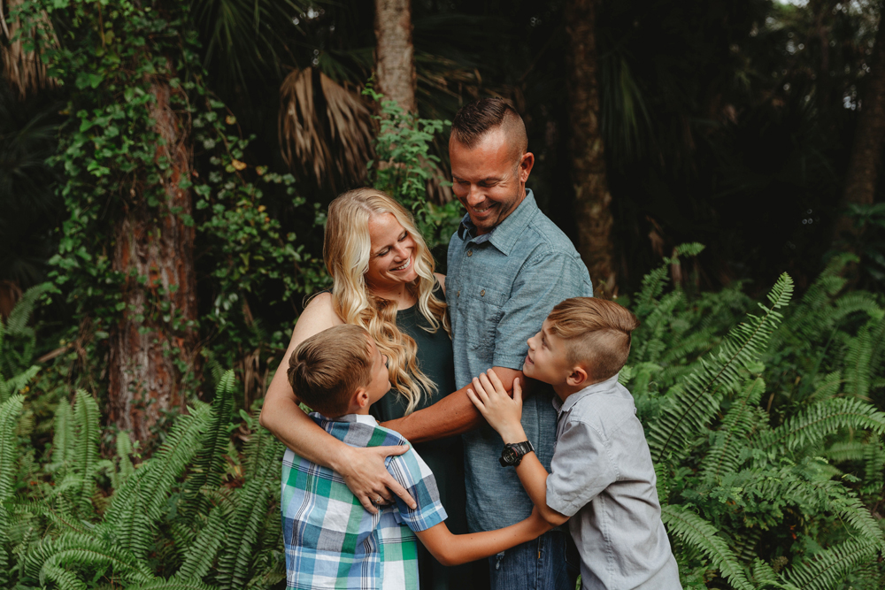 Naples Family Photographer, family smiling and looking at eachother