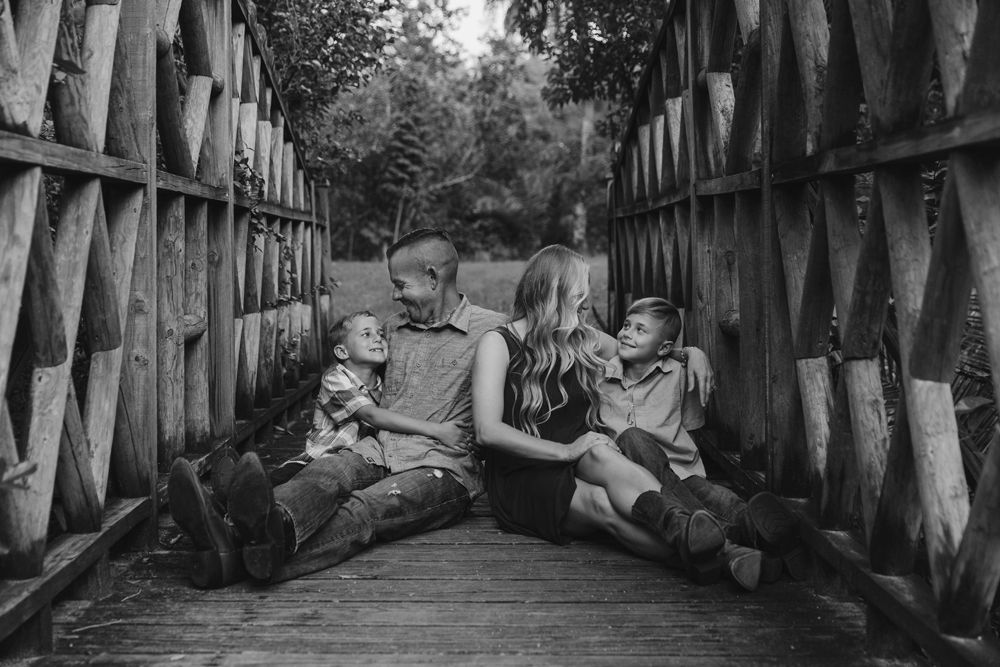 Naples Family Photographer, family sitting on a bridge together