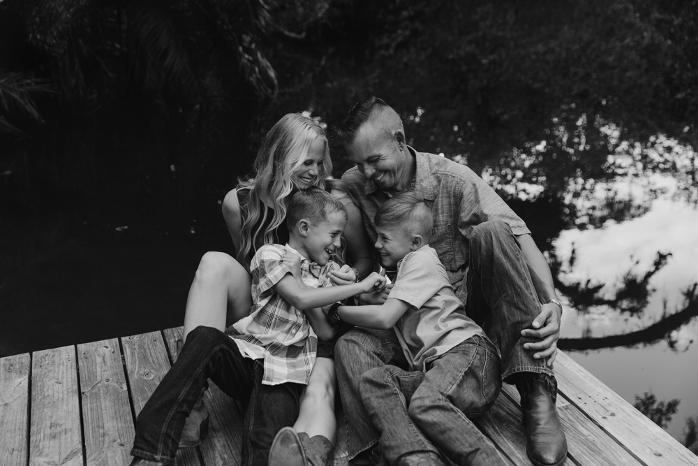 Naples Family Photographer, family of 4 sitting together