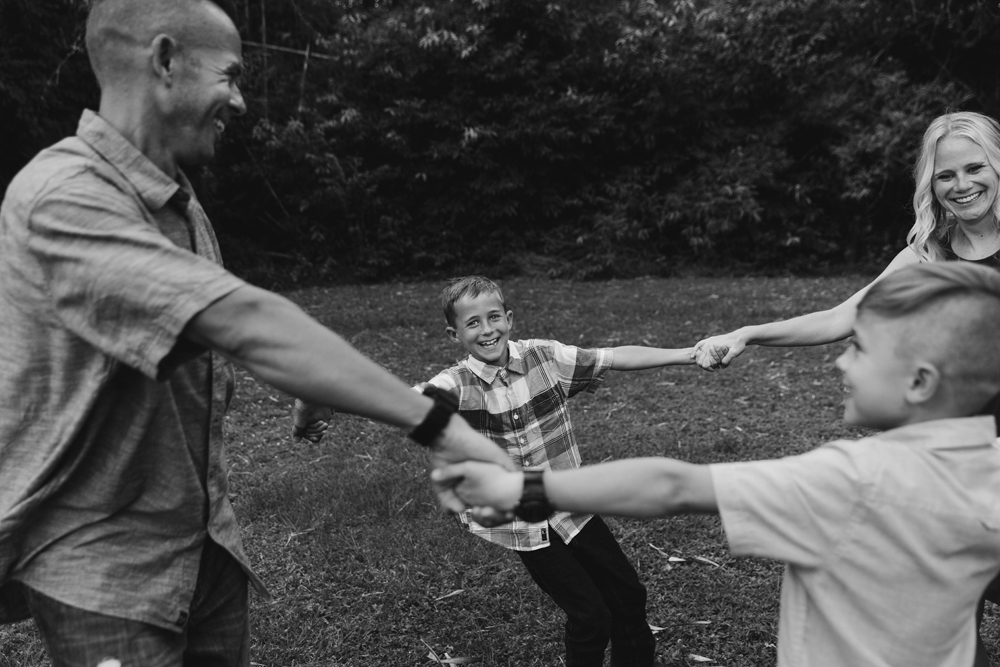 Naples Family Photographer, family holding hands and moving in a circle