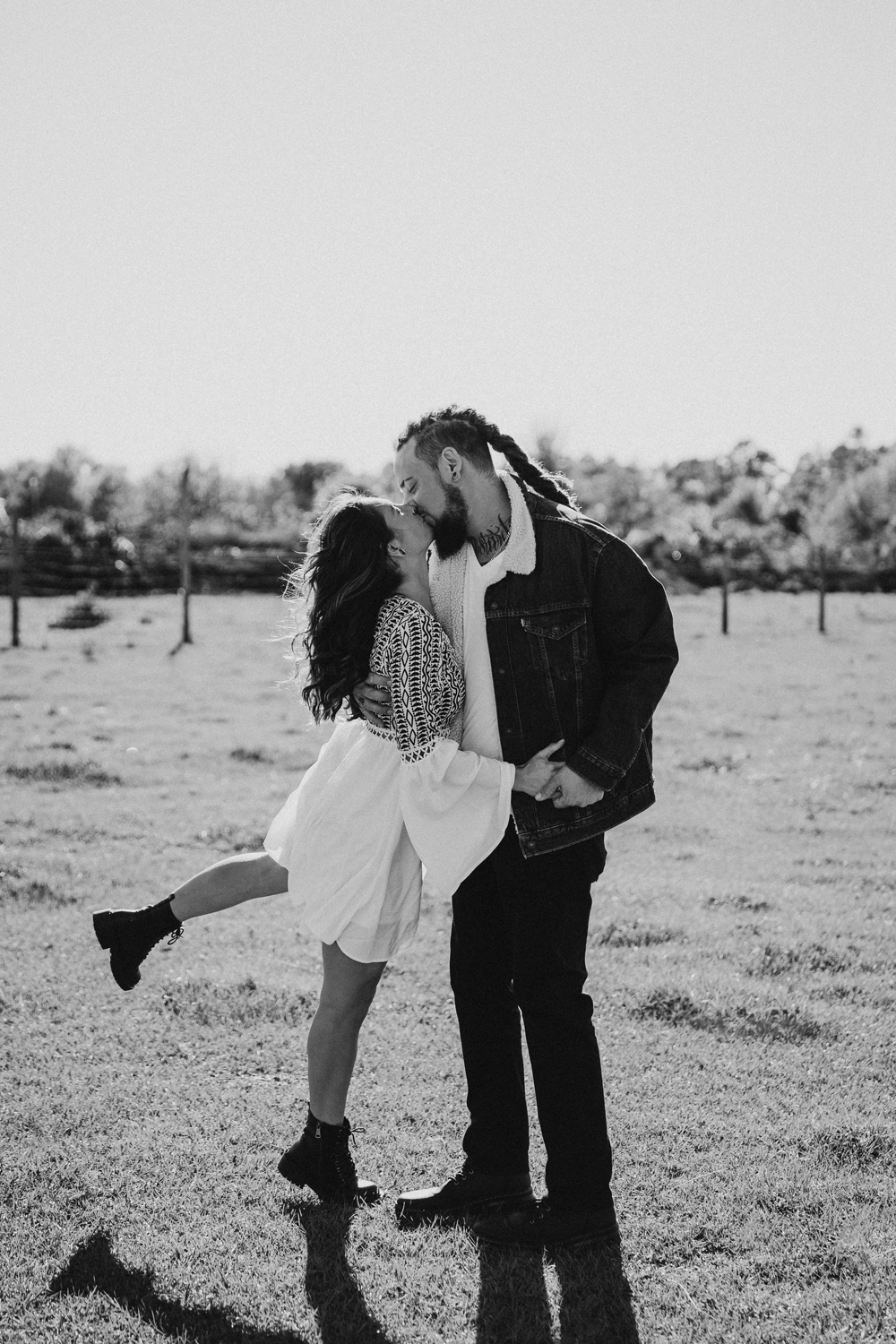 Naples Couples Photographer, black and white of couple kissing in a field