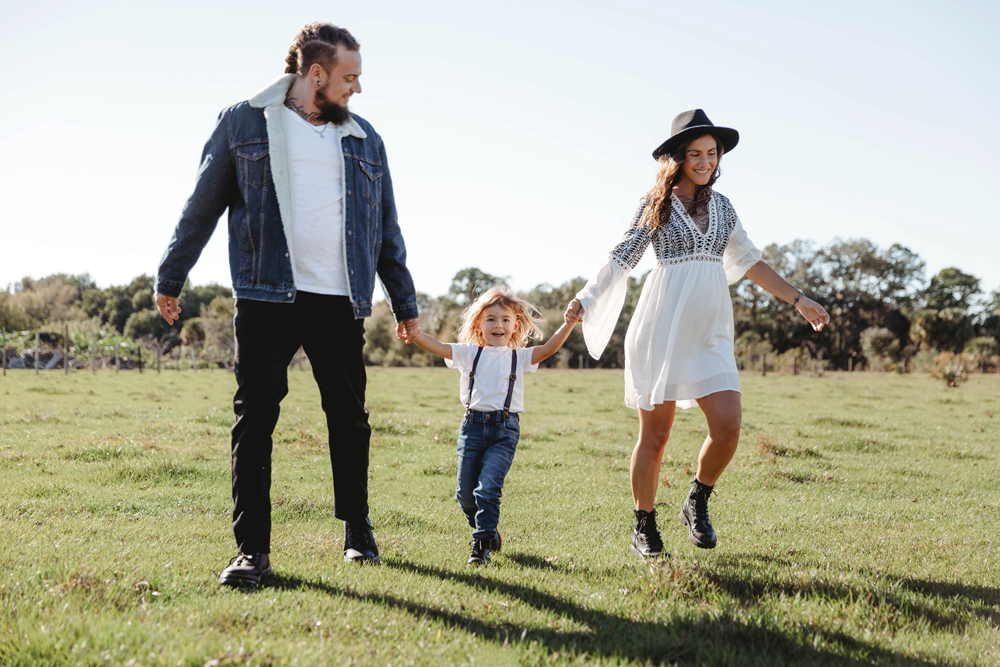 Naples Family Photographer, family walking in grass