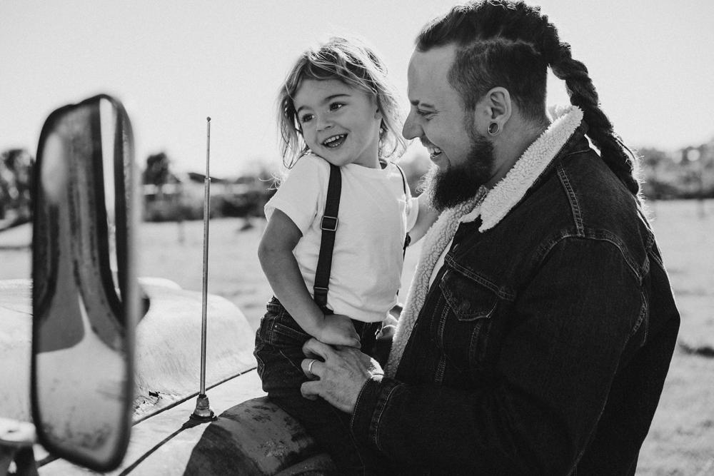 Naples Family Photographer, father and little son sitting on a truck