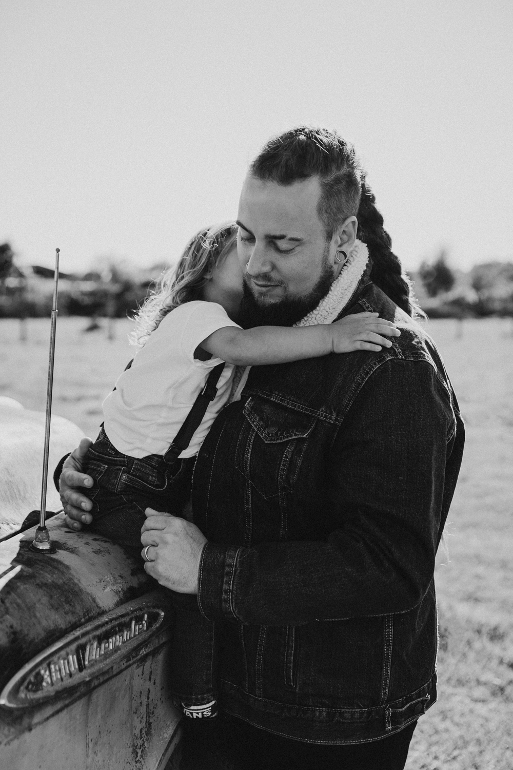 Naples Family Photographer, father hugging little boy