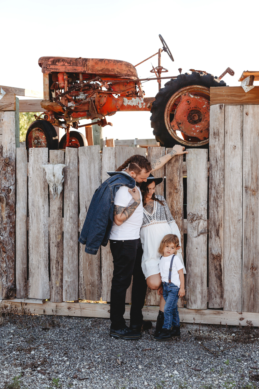 Naples Family Photographer, family standing next to white fence