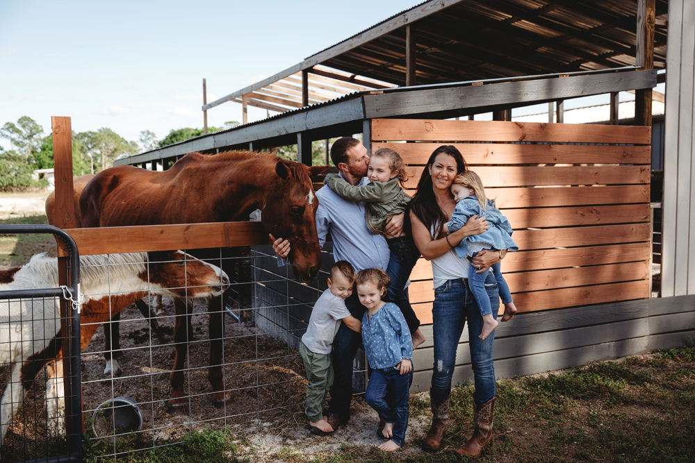 Naples Family Photographer, family of six standing next to a horse