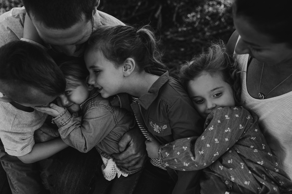 Naples Family Photographer, family hugging each other