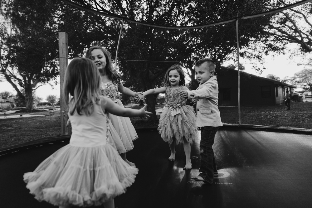 Naples Family Photographer,  kids playing on a trampoline