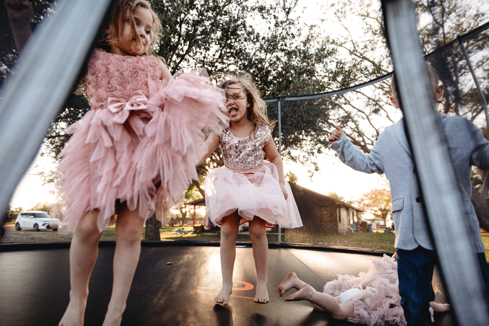Naples Family Photographer, kids jumping on trampoline