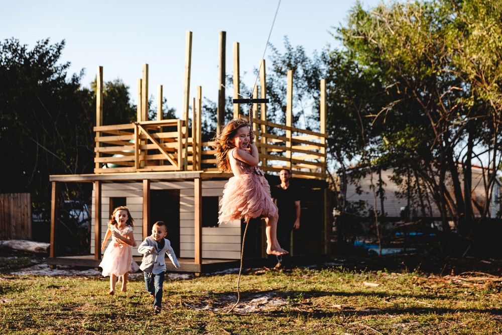 Naples Family Photographer, kids playing on a homemade zipline