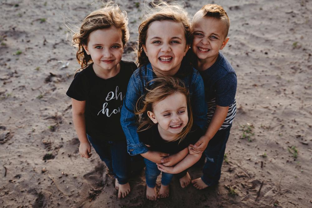 Naples Family Photographer, four children standing on the beach