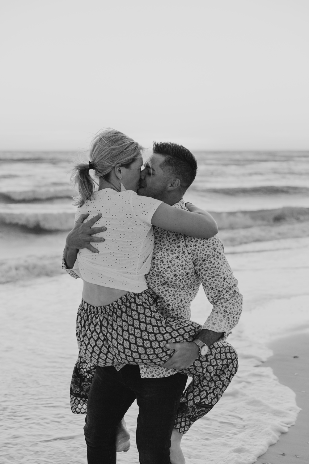 Naples Couples Photographer, black and white of couple kissing on the beach
