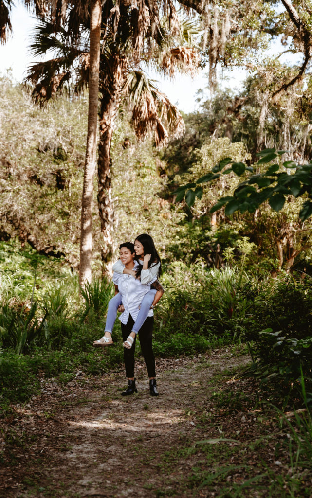 Naples Florida Couples Photographer, Lesbian couple giving each other a piggyback ride