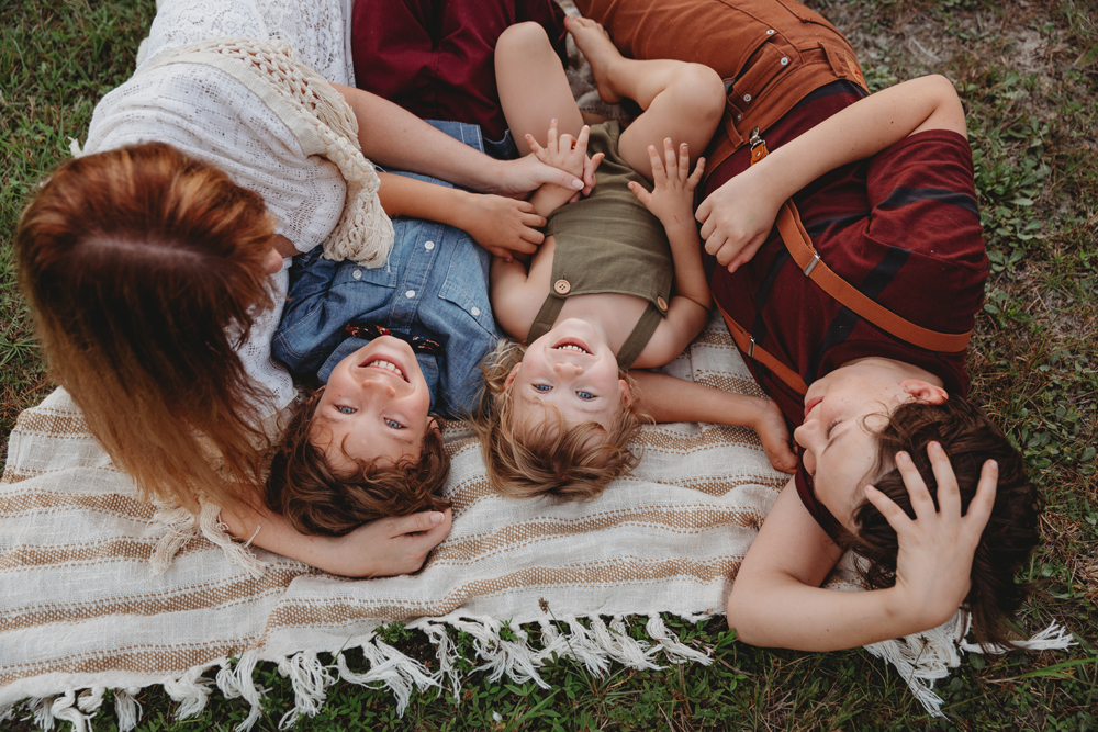 Naples Family Photographer, family laying on a blanket