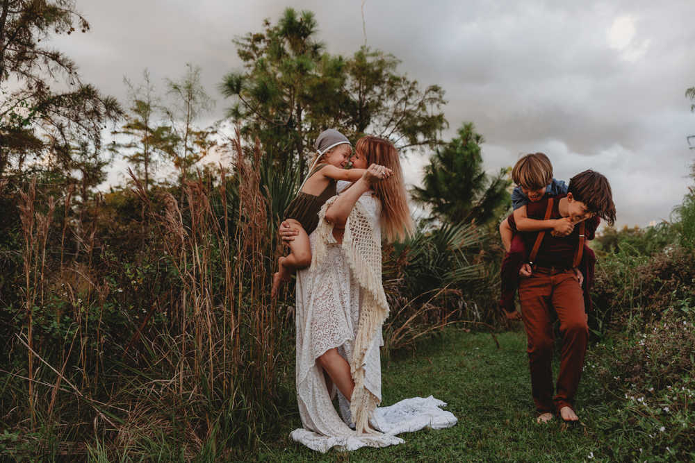 Naples Family Photographer, mother dancing with young son