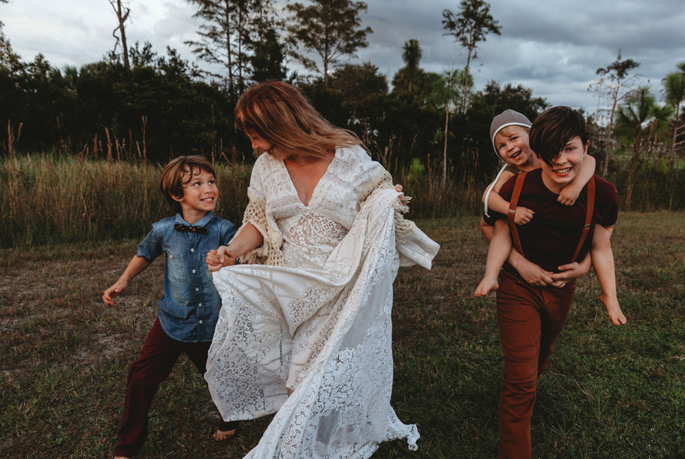 Naples Family Photographer, mother and sons running together